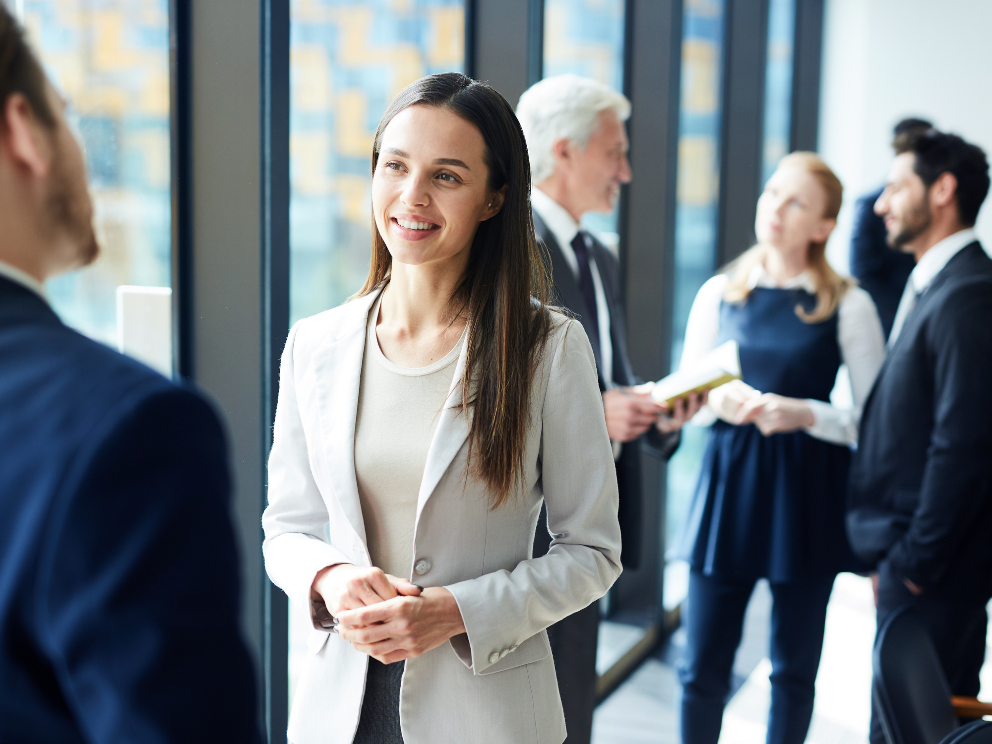 Pretty business lady talking to colleague